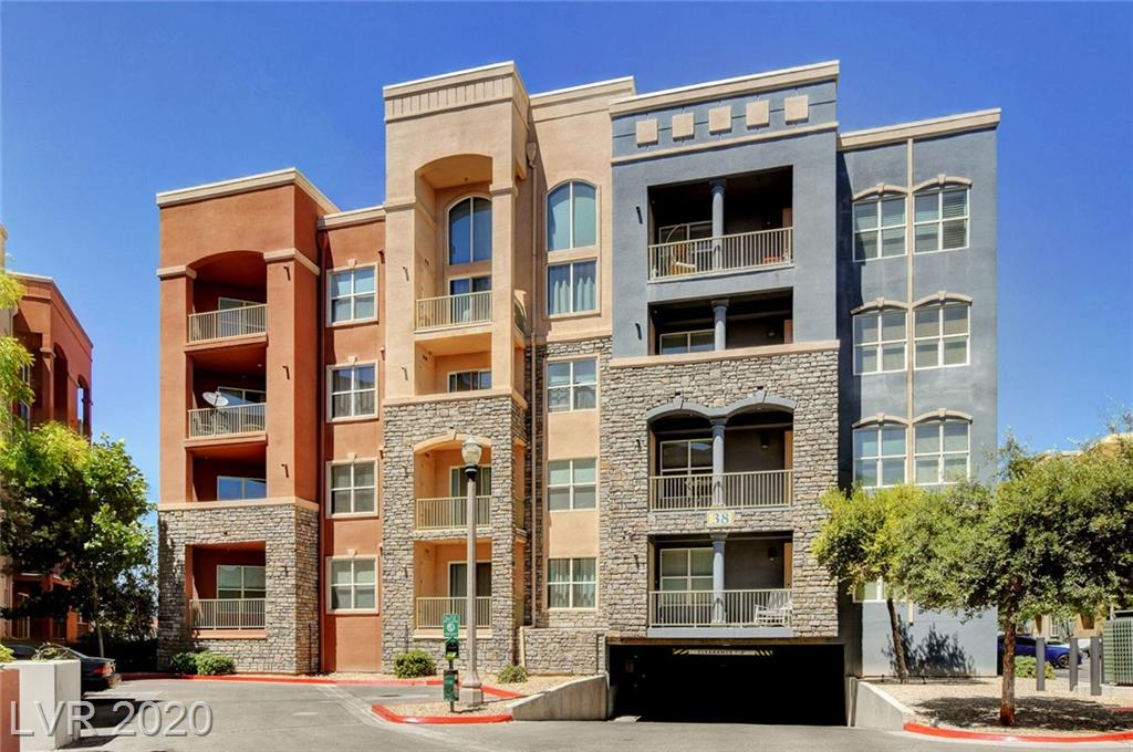 ABSOLUTELY GORGEOUS 2 bedroom upgraded Condo in the Manhattan Guard Gated Mid-rise! Located only minutes away from the brand new Las Vegas Raiders Stadium! Beautiful granite countertops with stainless steel appliances.  Custom Paint, balcony with views, tile flooring and plush carpet in the bedrooms. Large Master bedroom with walk in closet, bathtub and shower! Pristine Condition.  AMAZING LOCATION AND GREAT PRICE!