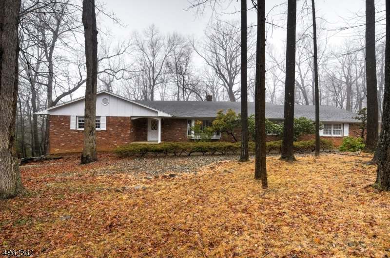 This sprawling ranch is located in the heart of the Watchung Mountains.  There are 3 spacious bedrooms on the 1st level with an eat-in kitchen, formal DR, formal LR, and family room with beamed ceiling and a wood burning fireplace.  Accessed from both the family room and laundry room is a screened in porch to relax in.  There are 2 full baths on his level and a powder room. The laundry room is conveniently located on this level as well. The finished basement has another full bath, with 2 finished spaces and walk-out to the backyard.  There are hardwood floors in many of the rooms beneath the carpet.  This home is conveniently located to major highways, shopping, and transportation.