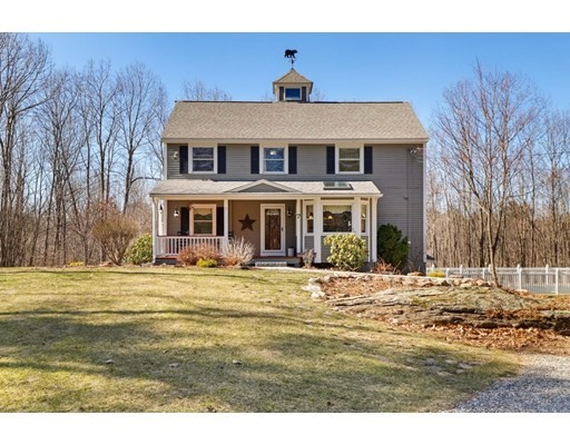 Set back on a quiet road w/a rounded driveway leading to 2 car garage at the partially finished basement level. New granite steps lead to the farmer's porch & front entrance, where you're greeted by the updated kitchen w/granite countertops, backsplash & two tiered island w/cafe bar, walk-in pantry, & cozy eating area adorned by bay window w/window seat, & skylight above! 1st floor also includes an office, formal dining room, & the great room, w/custom fieldstone chimney built w/stones from the property! Loft ceilings w/skylights & ceiling fans rise to the 2nd fl, where you'll find the 2nd floor's master bedroom, w/walk-through closet & large interior room, which could be converted to a bathroom or office. The primary boasts a private balcony overlooking the large lower deck & 20'X40' inground pool w/diving board! 2 more bedrooms & full bath w/jacuzzi tub complete this floor. In the attic, which has great storage, there's a cupola for 360 degree views of the property!