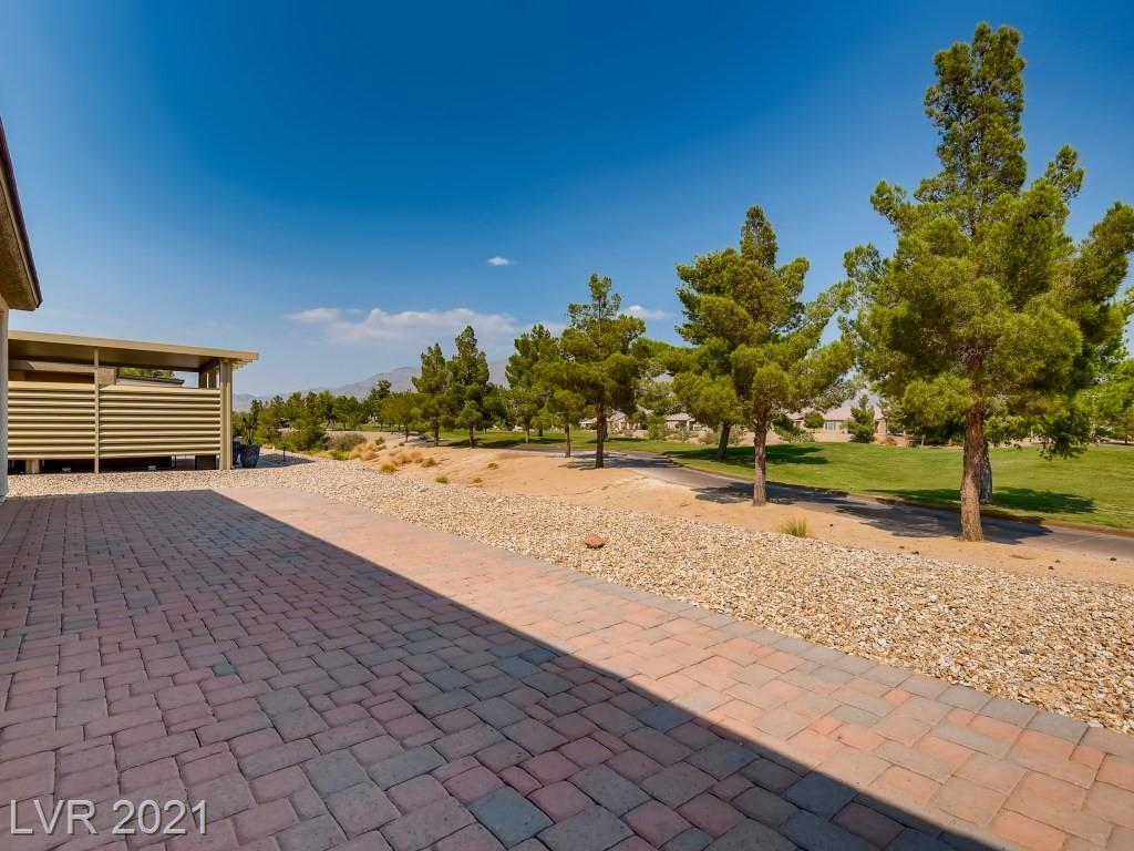 Incredible golf course and mountain views off the extended back and front patio.  Lots of windows for natural light. This immaculate home was used as a second home and barely lived in. All tile flooring throughout main areas and carpet in bedrooms. Separate dining area and oversize great room, perfect for entertaining. The kitchen includes stainless steel appliances, granite countertops, and a custom backsplash with a breakfast nook and pantry. Spacious primary bedroom, separate from other 2 bedrooms with a large walk-in closet. Silent running Ceiling fan/lights in all rooms. Garage floor epoxy finish. Exterior painted 2018. Great location in the community with easy access to the main road, shopping, and freeway. Community features: Indoor swimming pool, spa, fitness center, meeting rooms, tennis court, and social calendar.