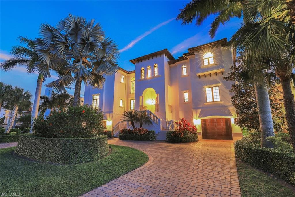 With a masterful design that showcases long majestic VIEWS OF VANDERBILT LAGOON and DIRECT GULF ACCESS, this meticulously constructed and maintained 3-story residence in Conners provides everything one needs for an incredible boating lifestyle.  It is evident the home is exceptional from fine details like custom mahogany double entry doors, architecturally designed ceilings, marble and hardwood flooring, a wood paneled elevator, stunning kitchen finishes, and a grand staircase with intricate wrought-iron railings.  At nearly 6,400 sqft of living area, and 11,500 total area, there are 5 en-suite bedrooms with 5 ½ baths, office, library, media room, and a 3-car garage.  Expansive terraces on all three levels provide amazing outdoor living space that overlooks the sparkling blue pool and spa as well as the private boat dock with 10,000 lb lift.  The home sets the standard for quality with poured concrete floors and walls, new AC, new hot water tanks, and new pool equipment. It also boasts an enviable location just a short walk from Vanderbilt Beach and a stone's throw from upscale shopping, dining, and nightlife at Mercato, Pavilion, and the Ritz Carlton Resort!