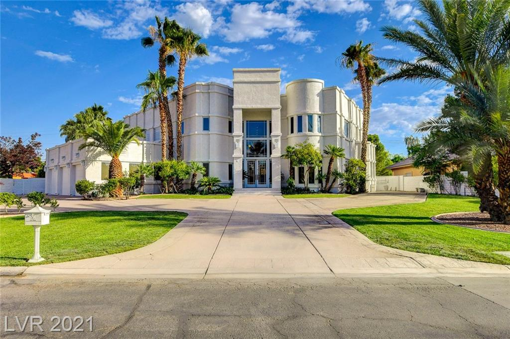 Welcome to The Commander Palace! Fully open design with lots of privacy.  This very unique custom home is located in it's own private cul-de-sac w/only 3 other homes. HOA only $100/mo. Huge driveway. This gorgeous estate features 6 bedroom suites all w/ their own bathrooms & walk in closets! Home is sold fully furnished/complete turn key! Stunning high vaulted ceilings at entry w/ luxurious spiral staircases on both sides. Resort style pool/spa w/ backyard kitchen grill plus a basketball court on almost an acre lot! LETS MAKE A DEAL! Fully electronic smart house with major upgrades with the follow items: 4 new HVAC systems, Ecobee Alexa Wireless Thermostats, Lights, Cameras, Pool & Spa (salt water with solar heater), Irrigation , Plumbing, Toilets, Water heaters, Paint, Sub Zero fridge, beds & frames with new linens and towels throughout! This massive estate truly has It all. Only 5-10 minutes away from the strip. Super close to convention center, major hospitals and airport.