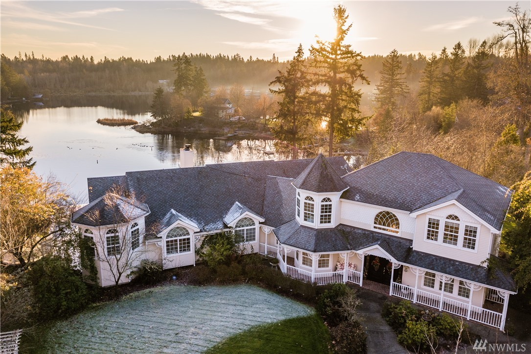 Victorian Lakefront Estate w/217 ft of Waterfront + 5 Private Acres! Amazing views from 1300sf+ wrap around deck. Perfect for Entertaining w/3 gazebos, waterfall, 100 varieties of roses + flowers. 3 Liv Rms, multiple Din Rms + fireplaces, game room + media rooms! Vaulted ceilings, crown molding, marble entry, hardwood floors, granite counters, 3-car garage, backup generator runs entire house, hot tub w/views. Great investment, Air BNB/ VRBO - dream vacation, kayaking, boat/ski, fishing, + more!