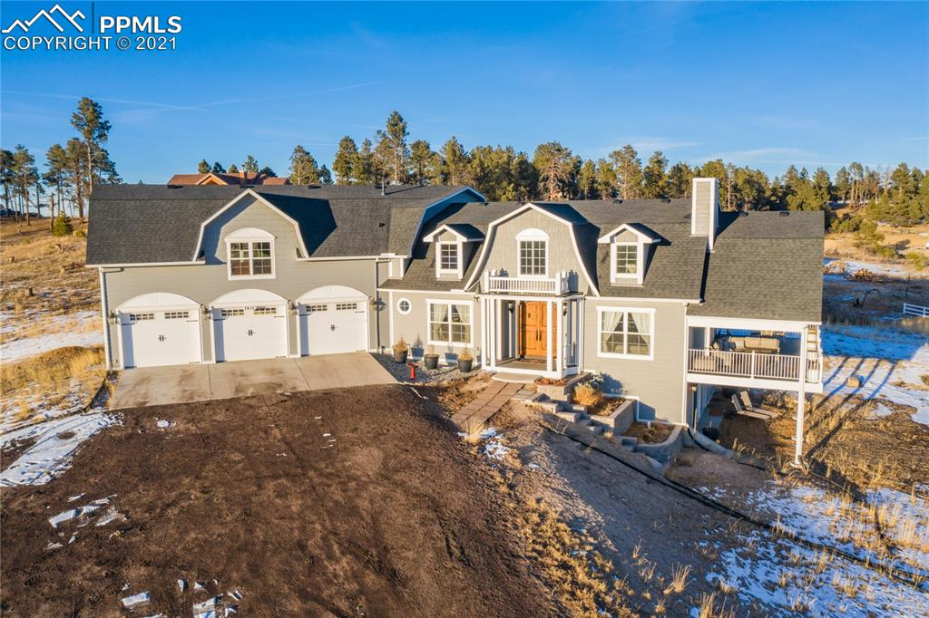 Newer luxury 1.5 story home boasts incredible views of Pikes Peak & the front range. comfort, convenience & modern upgrades throughout. Located in desirable Black Forest on 4.5 acres, w/easy access to main roads, & D-20 schools. The covered entry opens to the light & bright great rm boasting vaulted ceilings, gas FP, luxury vinyl plank floors, custom lighting & abundant windows that let the natural light pour in illuminating the open space. Nearby dining area can accommodate large tables creating the perfect layout to entertain friends & family. From here access the gourmet kitchen w/large island & breakfast bar, stylish counter tops, stainless-steel appliances, pendant lighting, walk-in pantry, & under cabinet lighting. From the great rm you can walk out to the covered composite deck capturing unobstructed views of Pikes Peak & overlooking the beautiful natural open meadow & treetops.  Back inside escape to the main lvl master suite w/ vaulted ceilings, LVP wood flrs, bump out window, walk-in closet & large private bath w/tile shower surround. Main lvl office has French drs, vaulted ceilings & built-in antique post office box storage. Hallway ¾ bath features a custom wine barrel vanity. Bonus upper lvl offers a 900+sqft. rec rm or jr. master suite/4th bedroom), the possibilities are endless! Pre- plumbed for a bathrm & offers incredible views of the landscape. Head downstairs to the walk-out basement w/ 9' ceilings, offering a large family rm flexible to all your needs; theatre, game tables, bar space & more! 2 large lower bedrms both have walk-in closets & access to the jack & jill bath w/soaking tub & modern tile surround. One basement bedrm has door to rear patio for private exterior entrance, ideal for separate living.  Additional highlights include antique sconces, pre-wired for Electric Vehicle charging, wired for spa, main laundry, RV parking, land to build workshop/detached garage & more! This home has been updated & offers privacy & views. See it today!