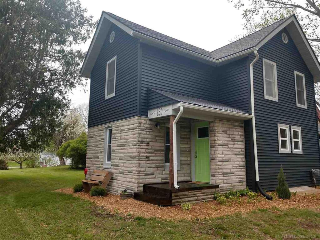 Restoration with a modern twist.  All new exterior, interior, Kitchen, bathroom, plumbing, roof, furnace, hwt, water softener, windows, well tank, doors, flooring, covered porch with metal roof, landscaping and more.  A lot of what's been done to this house cannot be seen.  Barn is 27 x 30 with a full height loft that could be an efficiency apartment or huge bonus room for entertaining.  The barn has new doors and electrical. The barn also has water.  If you seek some room to room but still close to town, then look no further.  Property has 2 acres, paved road, and backs to over 900 acres of state land with large wooded parcels across the street. Award-winning Brandon Schools.