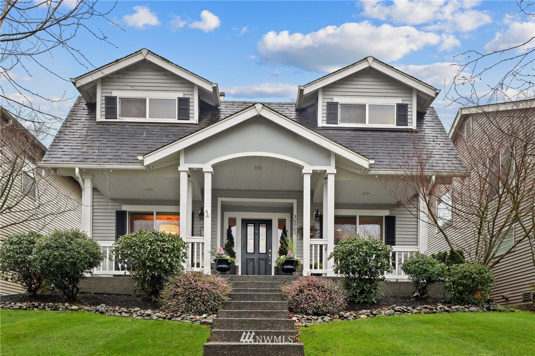 Located in the highly sought after community of Snoqualmie Ridge, this 4 bed 2.5 bath home features a welcoming front porch, fully remodeled and expanded Kitchen with quartz and stone countertops & updated appliances. Beautiful hardwood floors, modern pendant chandeliers, wainscoting & crown molding, designer paint colors, enhanced- 12 foot built in dining window seat with custom storage. Fenced yard, rear driveway gate, flagstone fire pit, expanded patio and custom arbor trellis. Welcome home!