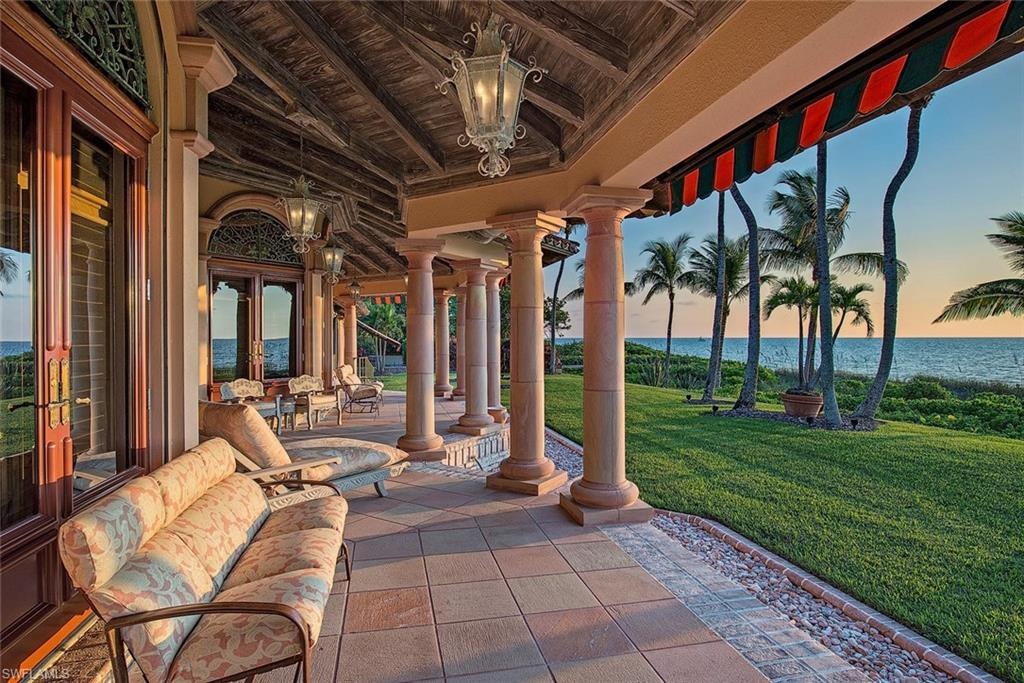 H.14115 - Over 1.5 acres and more than 150 ft. of direct beach frontage this is a rare offering. Magnificent panoramic Gulf views from nearly every vantage point! The pinnacle of beachfront luxury living in a small, gated enclave on Gordon Drive! This sprawling estate on a quiet, cul-de-sac street of just nine properties, offers just under 5,400 Sq.Ft. of living space featuring gorgeous custom stone, marble and wood flooring, detailed Artisan Guild custom millwork, exquisite chandeliers, multiple marble and stone fireplaces, a gourmet kitchen and upgrades throughout. Luxury lifestyle redefined! Spectacular, park-like grounds with meticulous landscaping, lush, tropical foliage and fish ponds create a haven for indoor and outdoor entertaining! Many distinct areas for gatherings, all with Gulf front beach access and mesmerizing views. Truly a remarkable slice of Naples' finest neighborhood.