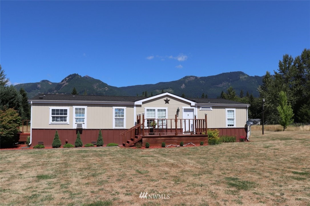 2 MH on 4.94ac. Both homes have many upgrades. Wood laminate flooring throughout. Both are freshly painted. 1992 Fleetwood 3bd 2ba 1568sf, back deck with a Gazebo.325sf machine shed and 282sf storage building. Backyard has views of northern hillsides while front yard has views of mountain Ridges. Plus a 1979 Golden Sunrise 1440sf 2bd2ba. The kitchen features custom maple cabinets with pullout shelves, breakfast bar w/stools. The backyard is fully fenced with 864sf shop.