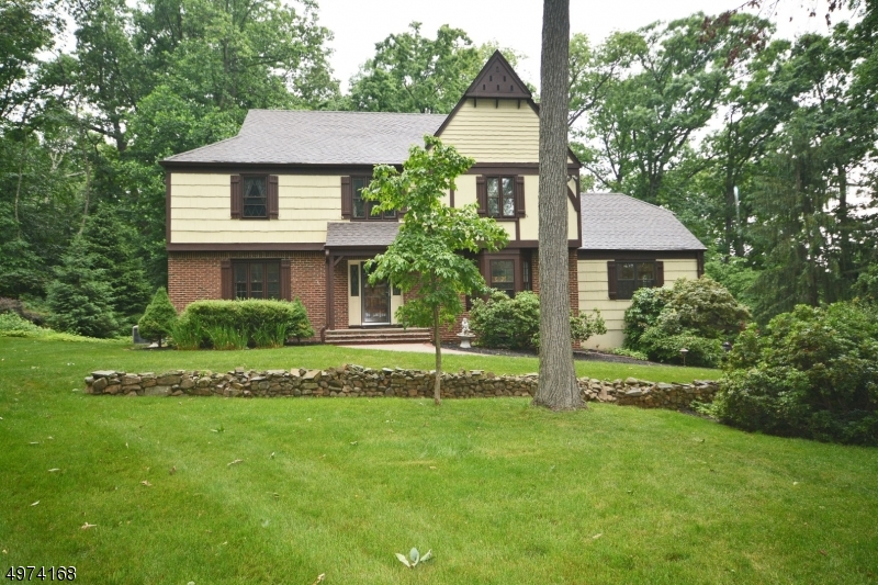 This warm and welcoming Tudor Colonial is set on a level 1.5 acre property on a tranquil cul-de-sac.  It's had continuous care and updating. Improvements include Timberline roof, Pella French doors, some windows replaced, generator added, updated kitchen and baths, 2020 hot water heater and dishwasher -  evidencing a pattern of continuous care.  Front to back spacious Living Room and family room allow for numerous windows.  Family room has lovely fireplace, bay window.  Kitchen has breakfast area with French door to deck. Adjacent laundry/mud room, 2 pantries.  Watchung is a sophisticated town with a small town sense of community.  Easy commuting via Rt. 78.