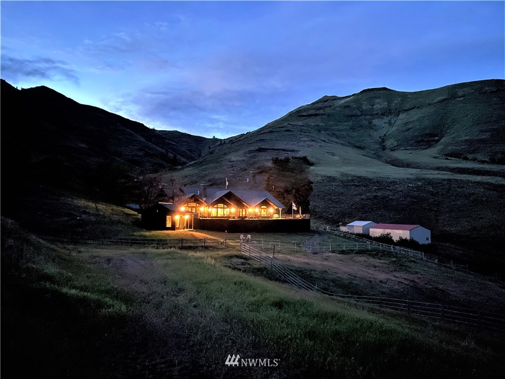 Once-in-a-lifetime opportunity to purchase this legacy ranch on the Grande Ronde River! The Sunrise Ranch is offered for the first time in 40+ years. 2,643 +/- contiguous acres, 1.3 +/- miles of deeded river frontage, world-class fishing and trophy deer, elk and upland game bird hunting make this property a sportsman's dream. Improvements include a 2,732 sq ft custom lodge-style home, guest house, historic barn, garage, wine cellar, game cooler and 2 shops. Pride of ownership and meticulous care are evident throughout. Locked gates and an expansive internal private road system ensure your privacy and seclusion. It is rare for a ranch of this size with deeded river frontage and impeccable land and improvements to come to market.