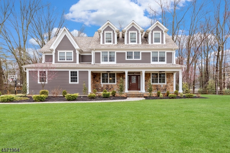 Impressive 6 bdrm 5.1 bath  residence offers a desirable floor plan w/ 4 levels of living space! The gourmet kit is a chef?s delight, with a fabulous center island, ss appliances, and a large pantry. FR with gas fpl ,FDR w/ coffered ceiling, wainscoting, and beautifully inlaid floors. 1st flr also has a  guest bdrm w/ full bath, a mudroom w/ built in cubbies, and 1/2 bath. The MBDRM suite offers  tray ceiling, sitting room w/ gas fpl, and 2 walk- in closets. The spa- like MBath features an oversized shower + jetted soaking tub. 3 more bdrms , main bath  + laundry room complete the 2nd flr. 3rd flr offers a private suite w/ a full bath and large closet/office. The incredible finished basement with 13 feet high ceilings has a spacious full kitchen, gas fpl, a large rec room, a workout room and full bath .