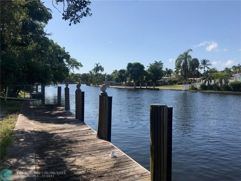 This is an investment opportunity, premier Coral Ridge waterfront location. This ranch style 4 bedroom 2 bath pool  home is on a 13,000 Sq. foot lot. Lots to room build or renovate you dream property. Easy to see call Listing agent