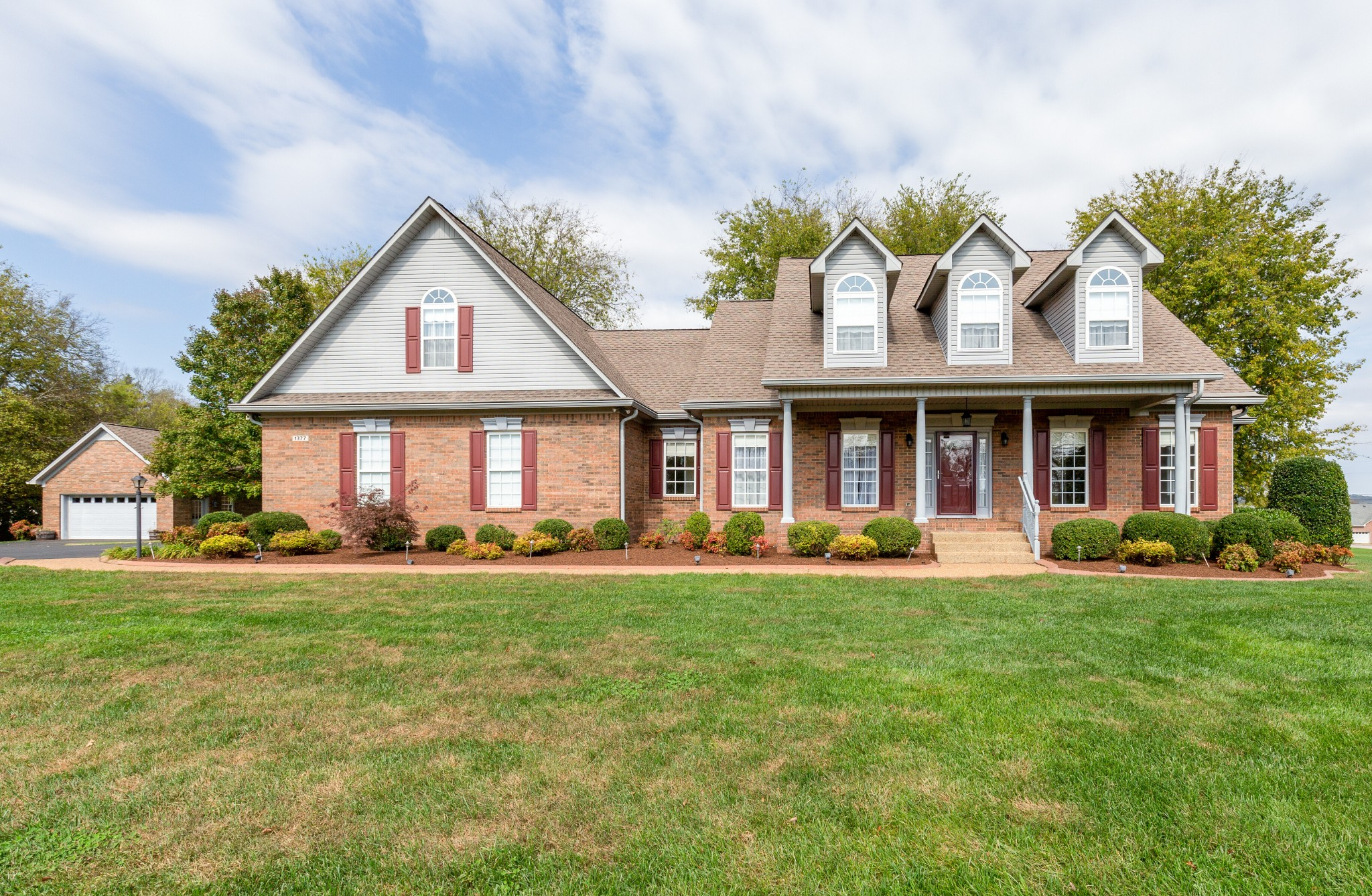 Beautiful all brick home on level 1 acre corner lot. You will be proud to welcome your friends and family to 1377 Charleston Ln. Perfect location. 10 minutes to The Crossings, 10 min to 840, 15 min to I-65, 20 min to Franklin. Home showcases beautiful wood floors, oversized bedrooms, & plenty of storage in the bonus room. Features: irrigation system, storm shelter in garage, central vac system, gas logs, additional 20 x 24 detached garage. Beautiful landscaping! New carpet in bedrooms/closets