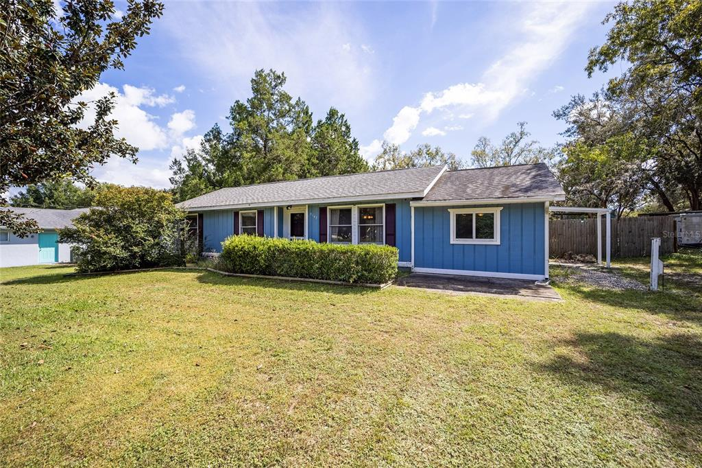 Looking for a home that was made for the person with a green thumb? Look no further, this 1262 sf  home situated on over a half acre of gardens, trees, koi ponds, a pool, and a screened-in lanai to take it all in. Walk in and you are met with a vaulted roomy living room that is open and airy. The galley style kitchen features updated cabinets and a brand new sliding glass door leading to the lanai. This 3 bed, 2 bath also has a second living area for guests, a gym, or whatever the heart desires. Come see for yourself!