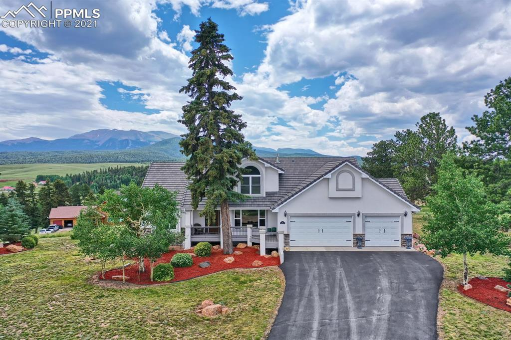 Absolutely stunning 1 owner, custom built home! It has the WOW factor in every single room. Custom bar that is off the charts in its beauty! It even has a black walnut built in cutting board from their family farm. Surround sound, beautiful wood floors. HUGE Views of Pikes Peak, Tarryalls & the Northern mountains. Formal dining room with big mountain views. Almost every room has AMAZING VIEWS. Tray ceilings & lots of recessed lighting. The curb appeal is just as beautiful as every other aspect of this home. Its a Must see!