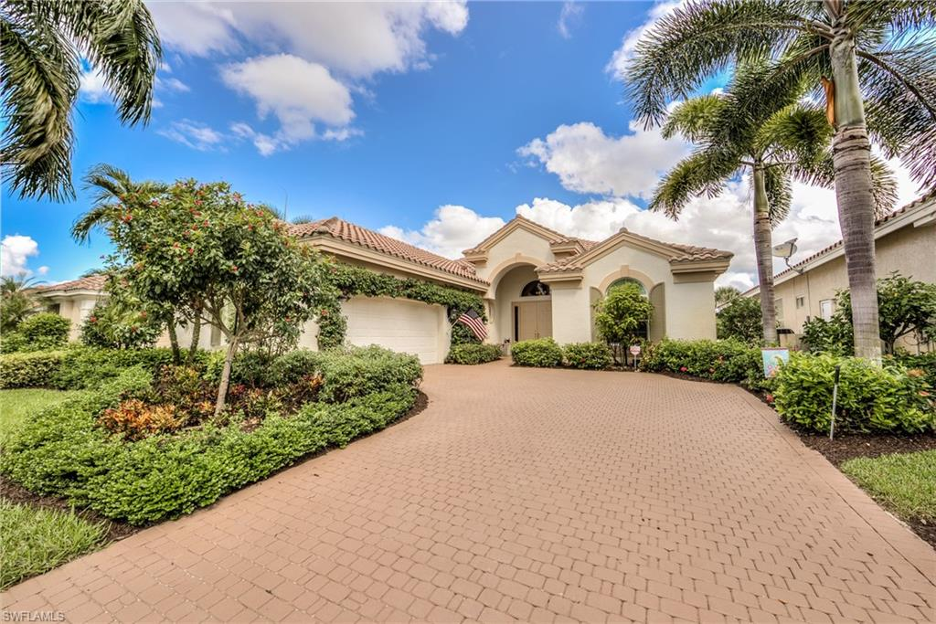 H.15135 - Gorgeous!  This home, located in the highly sought after neighborhood of Ginger Pointe is one of the largest modified Bardmoor models in all of Shadow Wood.  One of the best views in the area...gaze across the water to two golf holes from your travertine-floored lanai. New pool cage with panoramic screen walls.  NATURAL GAS heats your pool and spa.  Spacious dining area. Dry bar with fridge. Over 125 sq. ft. of over head storage racks in the garage. Water treatment unit, reverse osmosis in the kitchen, state-of-the-art stainless GE Profile appliances include Advantium wall oven and warming tray.  Newer pool equipment and air conditioner.  Total storm protection includes impact glass, electric shutters and lightning rods. Roof certified. Member owned Shadow Wood Country Club offers 54 holes of championship golf, 2 club houses, 9 Har Tru tennis courts, bocce, pickle ball, outdoor fire pits, access to a private beach club, fitness center, full service spa and private restaurant. Great location close to shopping, airport, beaches and much much more. Move right in!