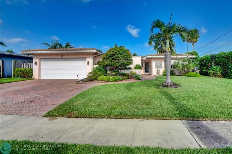 Ocean access pool home with new dock and 70 feet of waterfrontage.   Almost 2,000 sq ft under air & 2 car garage. Barrel tile roof with tie downs for insurance and hurricane impact doors and windows throughout.   Split floor plan with open layout perfect for entertaining.  Stainless steel appliances and 2 year old ac.   Oversized master bedroom with sitting area perfect for den or office.   Brick pavered driveway and pool deck.  Awesome views of intersecting canals.   Both bathrooms completely remodeled in the last two years.