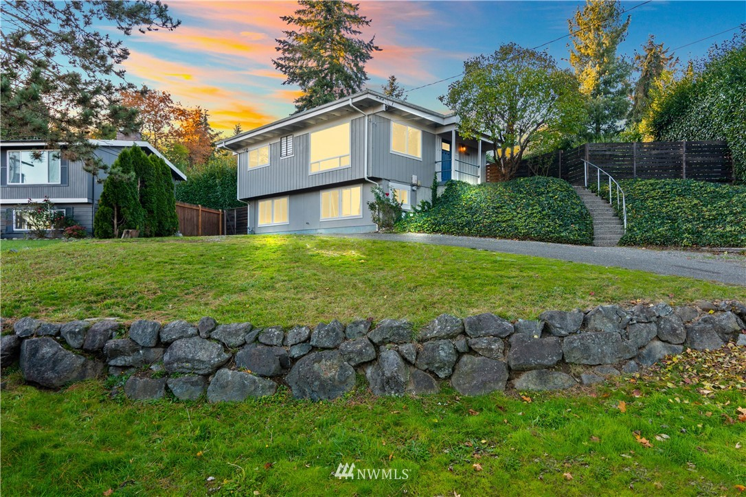 This fresh find is set back off the main road and enjoys striking Mt Rainier views! Gleaming floors, neutral colors, white millwork, thoughtful updates compliment the light-filled living spaces. Country-sized eat-in kitchen features cherry-toned cbntry, tile floors, SS applcs (all stay incl W&D), access to back yard. New furnace and water heater. Finished walk-out lower level: Indulgent primary suite offers stylish bath; bonus rm plus den, laundry rm. Covered deck overlooks yard framed by greenery, mature landscaping front and back. Outbldg for addtl storage; plenty off-street prkg. Stellar location to amenities, commutes, Southcenter, airport, Downtown Seattle. Ready to close!