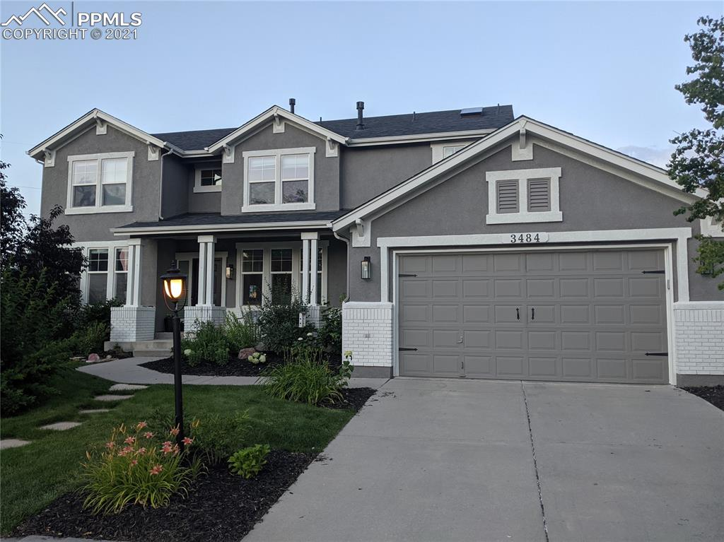 """Beautifully updated home in the very desirable Pine Creek neighborhood. This traditional 2-story home is situated at the end of a cul-de-sac on one of the biggest lots in Pine Creek with easy access to shopping, walking distance to D-20 schools & main roads. Main level has an open floor plan with beautiful 7"""" engineered hardwood flooring throughout, soaring 2-story ceiling in great room with built-ins, brick-faced fireplace, and floor to ceiling windows. The recently upgraded kitchen boosts newer stainless steel appliances complete with an ice maker, stunning quartz countertops, a big center island, a walk-in pantry and a farm style double-sink. The office overlooks the backyard with lots of windows, built-ins, and floor to ceiling bookcases. Walk out to the extended back patio with tons of room for entertaining and basketball. The expansive park-like back yard includes a playground, raised garden beds, and a separate fenced-off space on the side of the home.  The second floor has a lovely master retreat with plenty of space for a sitting area, a 5-piece bathroom with frameless glass shower, jetted tub, double vanities, private toilet room, skylight, and a spacious walk-in closet. Down the hall are 3 good-sized bedrooms which share a full bathroom with a double vanity and skylight. The basement has been recently finished with an additional bedroom, full bathroom, rec room, media room, and a big storage room, complete with lots of shelving.  The kids will have fun playing in the hidden room under the stairs complete with a sliding barn door. Additional highlights include: new roof & exterior paint 2020, 2 furnaces & A/C units with humidifier, new 50 gal water heater, whole house surround sound, low-maintenance stucco exterior, beautiful landscaping, and much more. This updated home, with an enormous backyard, is one of the most desirable homes in Pine Creek and will sell quickly."""