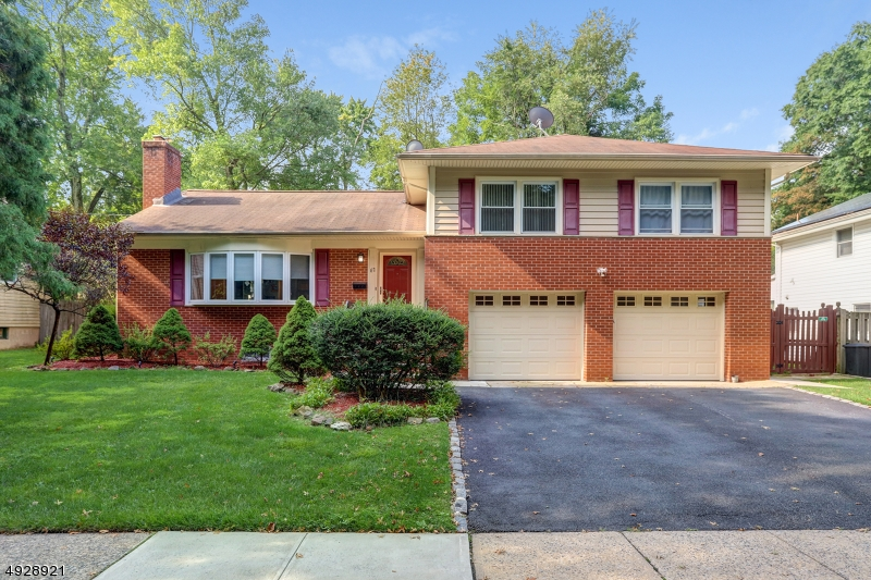 Totally renovated in 2016, this 4 Bed, 2.5 Bath split level is situated on quiet cul-de-sac & is conveniently located to schools, parks, shopping & NYC bus. Perfect floor plan for entertaining, the new chef's kitchen w/island, quartz counters & S/S appliances flows naturally into the D/R, spacious L/R w/fireplace & family room featuring cathedral ceilings & slider to new Trex deck for outdoor dining. The 2nd level houses the master suite w/private bath, plus 2 more bedrooms & another full bath. The ground level includes the 4th bedroom, laundry room w/extra toilet & garage entrance. The finished lower level features an amazing rec. room w/wet bar, powder room & large storage room. Beautiful HWD floors throughout, new baths, new light fixtures, new shed, freshly painted, CAC, fenced-in yard,plus much more!