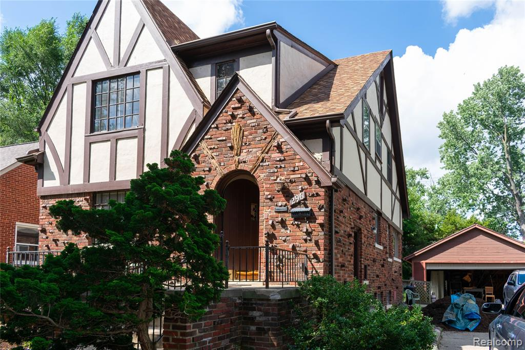"""Brick Tudor Built as Two Family Home on Nice Sized Fenced Lot within Easy Walking Distance of Downtown Ferndale.  Ideal Home for a Live in Landlord. Home has """"Good Bones"""" in  need of Updating which will earn Buyer """"Sweat Equity"""".  Both Units Feature Living Room, Formal Dining Room & Two Bedrooms all with Hardwood Floors, Kitchen with Granite Counters & Appliances & Full Bath.  Full Wide Open Freshly Painted Basement.  Newer Boiler, Hot Water Tank & Separate Electrical. Foam Insulated Walls. Two car Detached Garage (Needs Work)"""