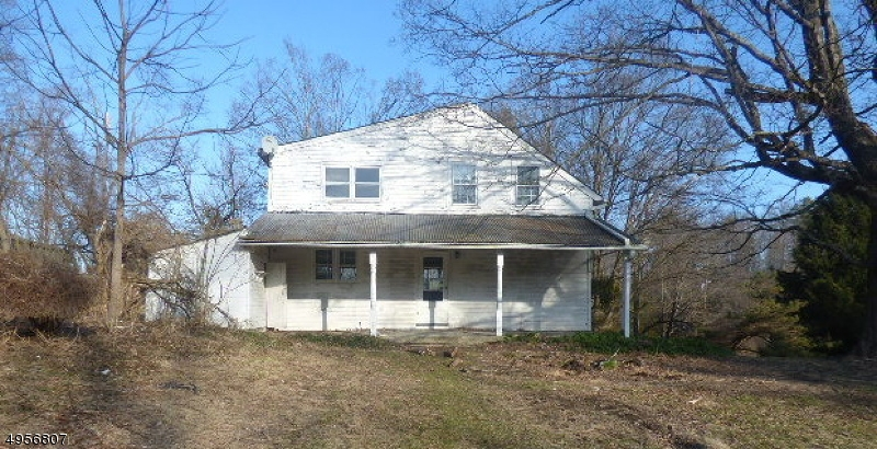 Large Colonial with 4 BR and 2 full bath on a large lot.  Beautiful original stone fireplace with insert. Wide plank flooring. Sold AS IS all inspections and CO are the responsibility of the buyer. Currently have multi offers. H&B due 9 AM 02/18/2020  Call for forms Please DO NOT ENTER BARN.