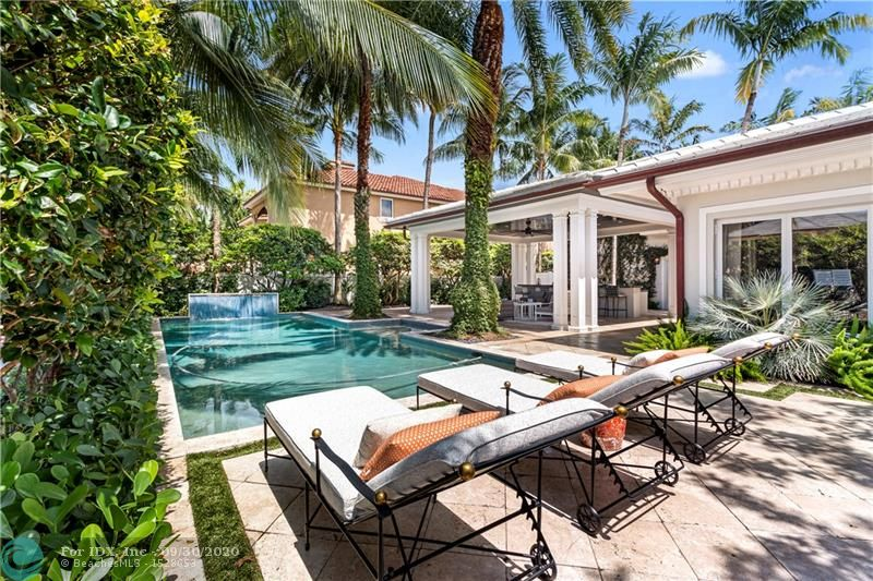 One of life's greatest luxuries is found in this deep waterfront estate. Inspired by a transitional contemporary design, rich with detail & design aesthetics. The tropical lifestyle is enhanced by a large covered loggia & custom summer kitchen overlooking the waterside pool & alfresco dining area. Ideal for the avid yachtsman with 100' of deep waterfront, 2 power stations & immediate access to the Intracoastal waterway. The luminous open floor plan is suited for entertaining with a large great room, cozy family room & elegant dining room. The heart & soul of your days will be centered around the custom kitchen, designed for the culinary chef. The master suite boasts a sitting area, morning bar, lavish bathrm & oversized walk-in closet. Full Home generator on natural gas. Sq ft from IMAPP.