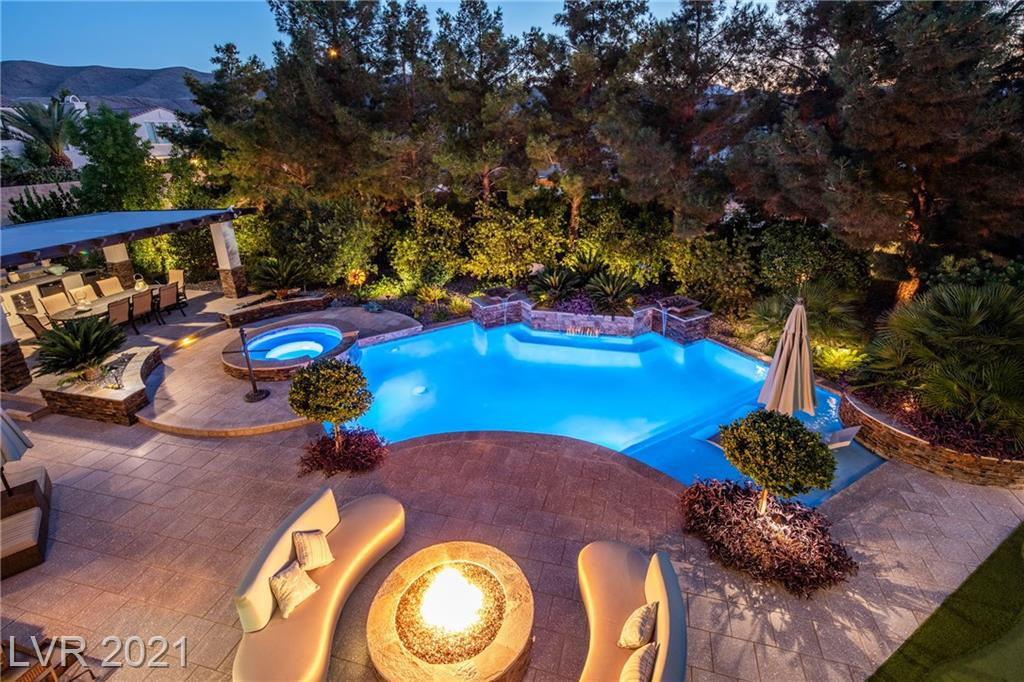 """This gorgeous renovated home sits on a rare .36 acre homesite behind the gates of S Highlands Golf Club. Perfectly manicured outdoor spaces create a private oasis. The French doors leading to the covered patio, opens to the pool and spa; surrounded by tranquil water features and fire pit. A pergola with BBQ and countertop seating overlooks the spacious side yard and pool. A spectacular setting for those who value outdoor space as much as interiors.  Entering the charming courtyard, you will notice a pride of ownership and design details. The home lives like a single story with the primary bed plus 3 guest beds downstairs. The upper level is accessed by courtyard stairs. A large secondary living area with wet bar and full bath, plus a balcony to a """"she-shed"""" overlooking the backyard. Inside find fabulous finishes and fixtures: chestnut hardwood floors, stone countertops, glass tile, smart home features and designer lighting just to name a few. Sub Zero and Wolf in the kitchen."""