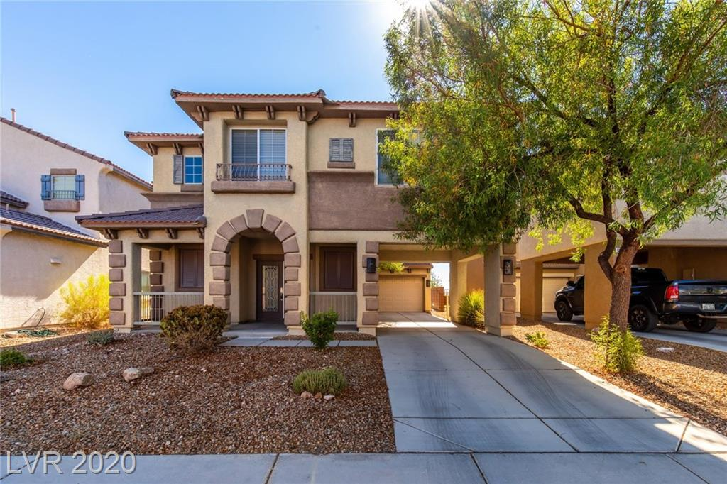 Stylish home situated in Monterey at Mountains Edge. Inviting covered front entry leads double leaded glass entry doors. Set back garage enhances curb appeal. Popular floor plan is open and bright offering flexible spaces including a mega loft. Kitchen opens to family room creating a perfect space for relaxing or entertaining. Kitchen treated to granite, quality cabinets, hardwood laminate, stainless steel range, and a french door leading to the covered patio. Master bedroom features a sitting room, ceiling fan, large walk-in closet. and views of the park and mountains. Spa inspired master bathroom is treated with a soaking tub walk-in shower, and more views. You will fall in love with the loft as it offers expansive space and a vaulted ceiling. Upgrades include updated two-tone paint, updated carpeting, stone pattern tile, and stylish baseboards. Backyard highlighted by a covered patio, park views, mountain views, and no rear neighbor for a sense of privacy.