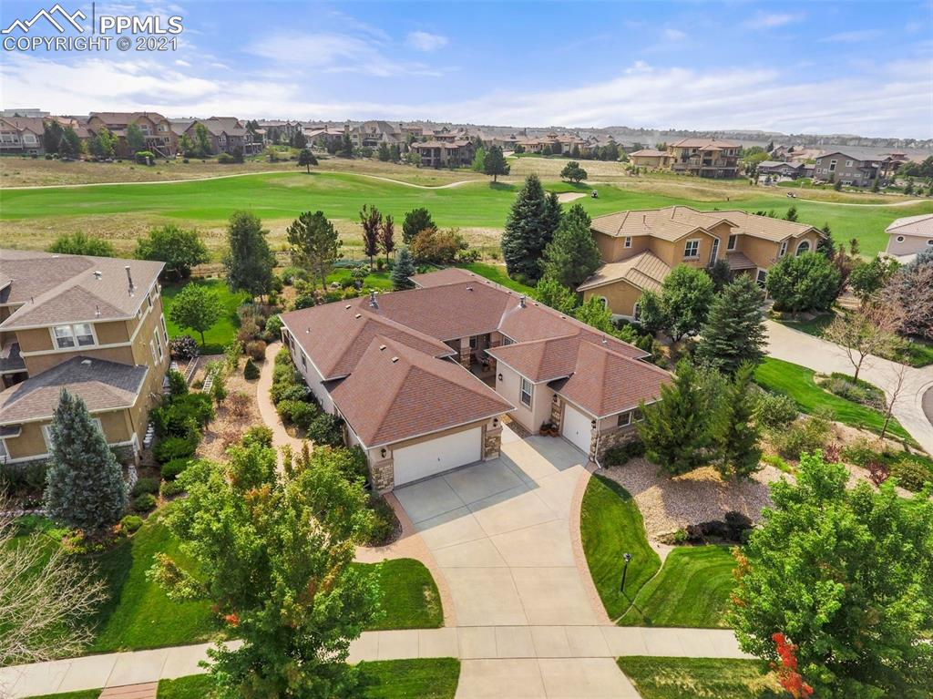 Incredible sunny Ranch home on the 6th Fairway of Pine Creek Golf Course* 5BR, 6 bath* TWO Ensuite (Junior suites) bedrooms w/ private full baths in addition to the Master Suite!* Plus Main level study with French doors* 9' Ceilings-both levels!! *Stucco Exterior* Large view windows* Super large newer Trex deck with stairs leading to lawn and garden* Dining room and master walk out to the spacious rear deck* Gourmet eat-in kitchen w/ natural hickory floors/ cabinetry, stainless steel appliances (newer dishwasher), convection s/c oven, gas downdraft cooktop* Spacious walk-in pantry*Dining room shares see-thru fireplace w/living room* Numerous walk-in closets throughout the home; two master bedroom walk-in closets* Brand new upgraded carpet & padding/ fresh interior paint- main level and stairs* Pre-plumbed for wet bar in large lower level family room w/ second fireplace* Two central air units/ Two furnaces/ Two fireplaces *Lower level used by original owner but unused since 2007...Move-in ready! Must see!