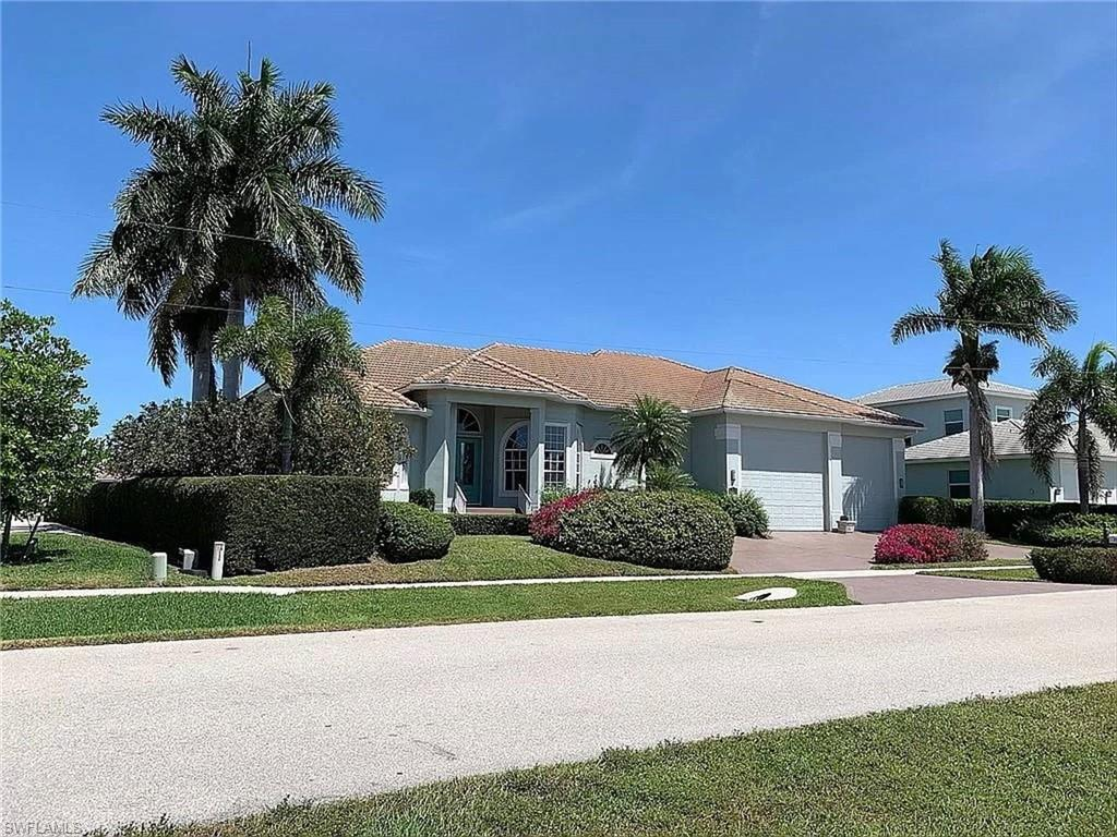 Beautiful home on Marco Island in the Mini Estates. Direct access to the Gulf; fishing, boat rides and beautiful sunsets from your dock.  Nice swimming pool area. Home sits on a 130' oversized lot. Close and easy access to beach, Publix , parks, schools, YMCA , restaurants, and entertainment .This home is unique on the Island it has a garage with 16' ceilings that can accommodate an RV etc. Beautiful Kitchen, custom cabinetry, granite counter tops, crown moldings, plantation shutters, 3 sizable bedrooms, Den/office can be used as extra bedroom, has French doors. 2 full baths and 1/2 bath inside home.1/2 bath outside pool area and an outdoor shower. Property also available for lease or seasonal rental.