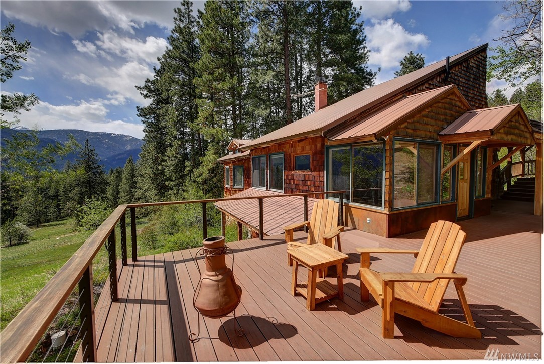 MAZAMA meadow and mountain views. 3 bed 2.5 bath craftsman home overlooking a 24 acre greenbelt. Barnwood dining room, exposed wood ceiling, woodburning stove,rustic stone hearth, full daylight basement. 2 car garage with LEGAL NIGHTLY RENTAL above. Aspen Loft is a grandfathered nightly rental. Owner upgrades:complete new electric system,decks,appliances. New community pool. Heart of the year round Methow trails system and world class nordic skiing. Mountain bike,hike,climb from your front door!