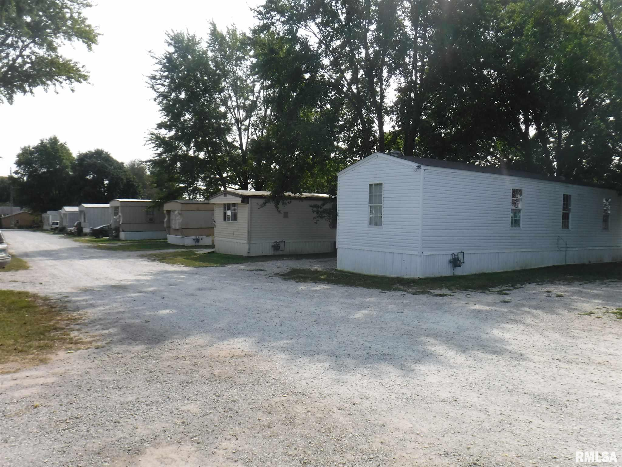 INVESTMENT OPPORTUNITY!! Trailer Park in Kinmundy, IL with 17 rentals up & running.  Right on the south edge of Kinmundy, IL is an investment opportunity waiting for a buyer.  1 house & 16 mobile homes with almost 2 acres included in the sale.  Many improvements! Financials provided with bank letter & signed confidentiality agreement.  Please see list of improvements.  Extra lot available at additional cost.