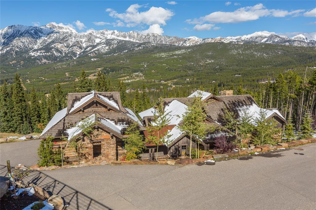 Exceptional views of the Spanish Peaks Range and traditional mountain elegance are exhibited throughout this custom residence. Situated in the heart of Moonlight Basin, this property has the perfect ski-in/ski-out location on over an acre of gently forested land. Come summer, the amazing ski access becomes your path to the ever-growing hiking and biking trails of Moonlight Basin and the broader Big Sky Resort. This elegant mountain retreat offers ample space for family and friends with 5 bedrooms, 7 baths, a 2 car garage, and a world-class ski room (complete with lockers, built-in tuning bench, boot heaters and plenty of storage for all of your mountain gear.
