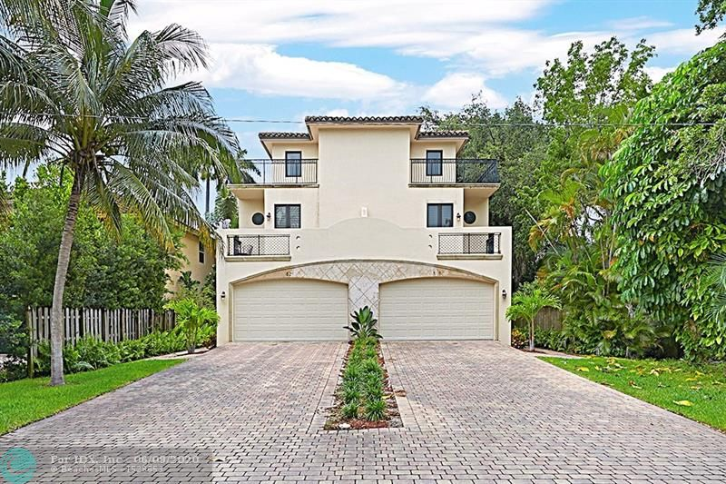 Gorgeous Tri Level Town home in sought after Tarpon River Neighborhood.  Over 3300sf under air with tons of storage & closets Already designed to allow for the addition of an elevator. 1st floor has an open floorplan with marble floors, kitchen, dining, living room plus a foyer half bath & deck . 2nd Floor has huge master bedroom with 2 walk in closets, master bath has dual sinks & separate walk in shower &bathtub. Laundry room, 2nd bedroom& full bath & additional bonus space Patios off both bedrooms. 3rd floor has 2 additional rooms with closets for a 4 bedroom or 3 bedroom plus home office or den& another full bath. The enormous rooftop deck is a fabulous place to entertain. So much home for the money, Fee Simple, No HOA, walk to the parks, shopping, coffee house& local brewery.