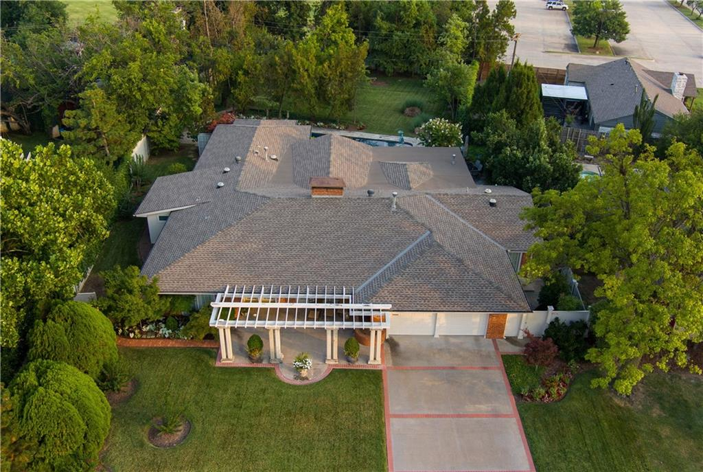 WOW!  True single story in Nichols Hills with pool on wonderfully landscaped half acre lot with mature trees.  This gorgeous home has so many features.  Wood floors and cathedral ceilings in Living, Dining and Master Bed.  Large open rooms with ample natural light and gorgeous views of yard.  Master Bed with Sitting Room and French doors to pool and backyard.  Master Bath has double vanities, separate tub & shower and large Walk-in Closet with built-ins.  There is even a separate storage closet with exterior entrance off of walk-in.  Master Hall with stunning wood carved accent doors houses the Utility Closet.  Separate Guest Bed overlooks front of home.  The Study/3rd Bed has en Suite Full Bath and gorgeous wood accents.  The delightful Kitchen has a center island with copper vent hood, double ovens, gas range, built-in refrigerator and microwave, seating area and Breakfast Room.  Close to Nichols Hills Plaza, Trader Joes, Whole Foods & more.  Spectacular in all regards!