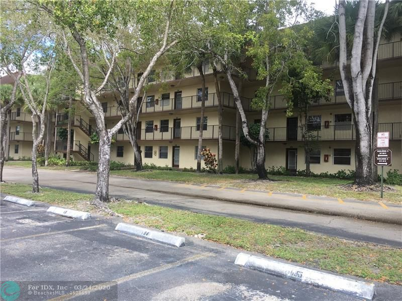Great opportunity to own a nice move in ready condo in a gated community. Spacious 2 bedroom, 2 bath condo with a large open concept living area with beautiful laminate wood floors throughout the condo. For outdoor entertaining it has a large private balcony to enjoy the gorgeous lake view. Huge master suite with walk in closet and remodeled master bathroom. Desirable location only minutes away from the beach, turnpike, and Sawgrass mall. All ages are welcome.