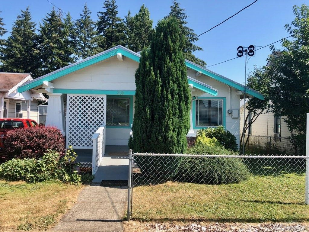 Craftsman Bungalow. Super clean! Detached garage behind with alley access. Fenced side yard. Move in ready. (Side driveway belongs to neighbor).