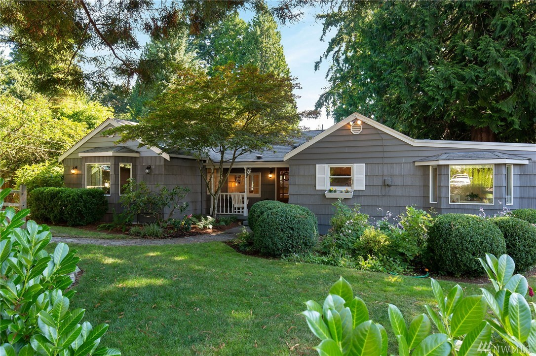Love this adorable cottage with your rocking chair front porch amid lush gardens for the most tranquil setting.  Beautifully updated inside with hardwoods throughout and great spaces for entertaining. The ship lapped dining room and spacious kitchen open easily outdoors for everyone to spread out. Sunny main bedroom with en-suite bath opens to the private deck and side yard. Lots of space for your in-home office.  Within the LFP Civic Center boundary on a quiet dead end. Get home, relax, enjoy!