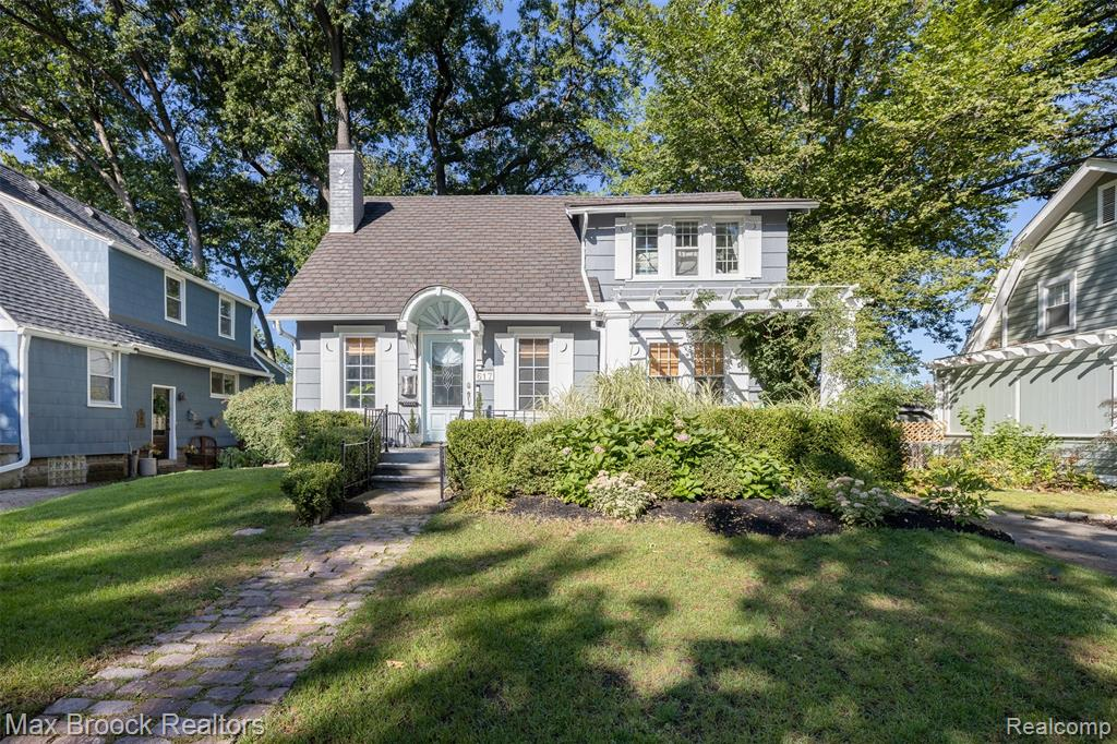 *highest and best* please have offers in by 4pm Sunday 09/12.  Great opportunity to move onto this idyllic, tree-lined street! This special historic home has all of the original charm of 1923 w/ thoughtful updates reminiscent of the era. The floor plan is open & bright w/ original built-in shelves below leaded glass windows, surrounding the gas fireplace, and a black marble hearth. Original wood floors throughout. Classic arched entry brings you into the formal dining room w/ easy access to the kitchen that has open shelving, quartz & stainless. Main floor bedroom that doubles as an office has ensuite half bath, & a closet that is the perfect size for a stackable washer & dryer (plumbed, machines excluded). Upstairs has 2 bedrooms, beautifully redone full bath & large walk-in hall closet. The storybook backyard is inviting w/ charming stone paver hardscaping, vine covered pergola, & extra seating area for entertaining. Built-in fire pit is great for crisp fall evenings. 2-car garage.