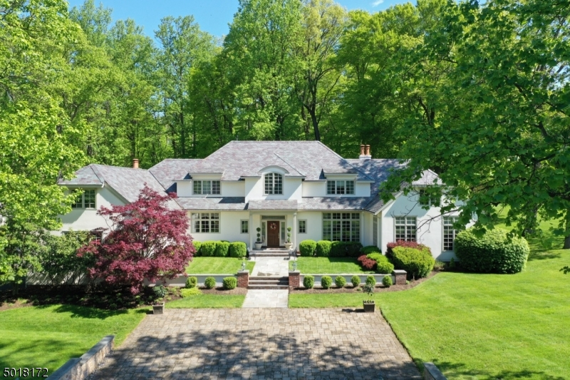 Exceptional European Manor crafted of stucco & slate set at the top of the Bernardsville Mountain. Mature plantings, courtyards & bluestone patios, pool/waterfall, pool house, & guest cottage. Set of 5 park-like acres, this home will exceed your expectations of luxury.  Spacious 5 BR, 5 bath & 2 half baths, open floor plan, hardwood floors, crown molding, architectural details throughout. First floor master suite adds the the flexibility of the floor plan.  Bonus playroom & in-law suite with ensuite & separate laundry.  2000s sf ft lower level with recreation room, gym and wine cellar. Just minutes from town, shopping and trains to NYC