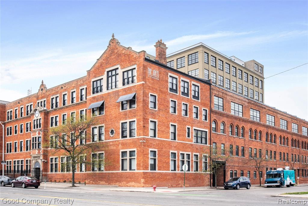 Welcome to this spectacular, two level corner unit, with views of the Belle Isle bridge & Detroit River. This historic building was built in 1908 as a pharmaceutical warehouse, then was converted to luxury condos in 2005, and updated in 2017. Amenities include secure, gated, and covered parking, an outdoor pool, hot tub, sauna and 24/7 fitness room. The unit's floorplan is laid out on two spacious levels, with a spiral staircase adding a striking element to the living room. The large rooftop terrace, accessed from the second floor, features a wooden deck, spacious enough for a full suite of outdoor lounge furniture with views to the river. The first floor balcony overlooks the pool and inner courtyard. The abundant exposed brick and extra tall windows bring the first floor to life. Two parking spaces included. Schedule your private tour today!