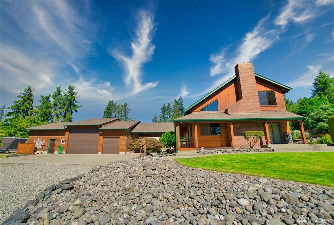 Gorgeous custom-built, one-owner home on a beautifully landscaped and fenced one acre lot! The owner built this himself and the quality and workmanship speaks for itself! Some of the inside features include cedar siding and cedar interior, soaring ceilings with skylights and ceiling fans, amazing floor-to-ceiling river rock fireplace, heat pump, and custom cabinets. The 36x50 finished garage is attached with a breezeway/carport and has a woodstove, 3/4 bath, RV door, and an office area.