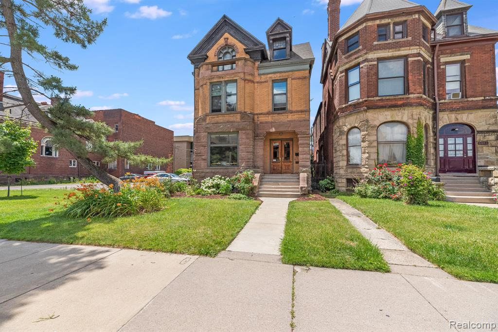 Do you want to have it all?  Step into this timeless beauty to feel the vibe of an era long gone.  One of only a few historic single family homes in Midtown, steps away from Wayne State Campus, Blocks from the Medical Center, a stroll from all the unique flavors and experiences of the restaurants and bars of the community, secluded tranquil outdoor space, convenient private off street parking and to top all of that off this home has had all of the historic charm carefully preserved with attention to every single detail (hello pretty fireplaces and wood work for days) while also updating so many areas of the home to reflect todays modern lifestyle that you will enjoy for decades to come!  If you want to further improve this property you can tackle the third floor with some finishing work and add an additional 2 bedrooms to make 7 total or finish the basement with the gorgeous exposed brick foundation into a speakeasy type hangout.  Prepare yourself to fall in love!