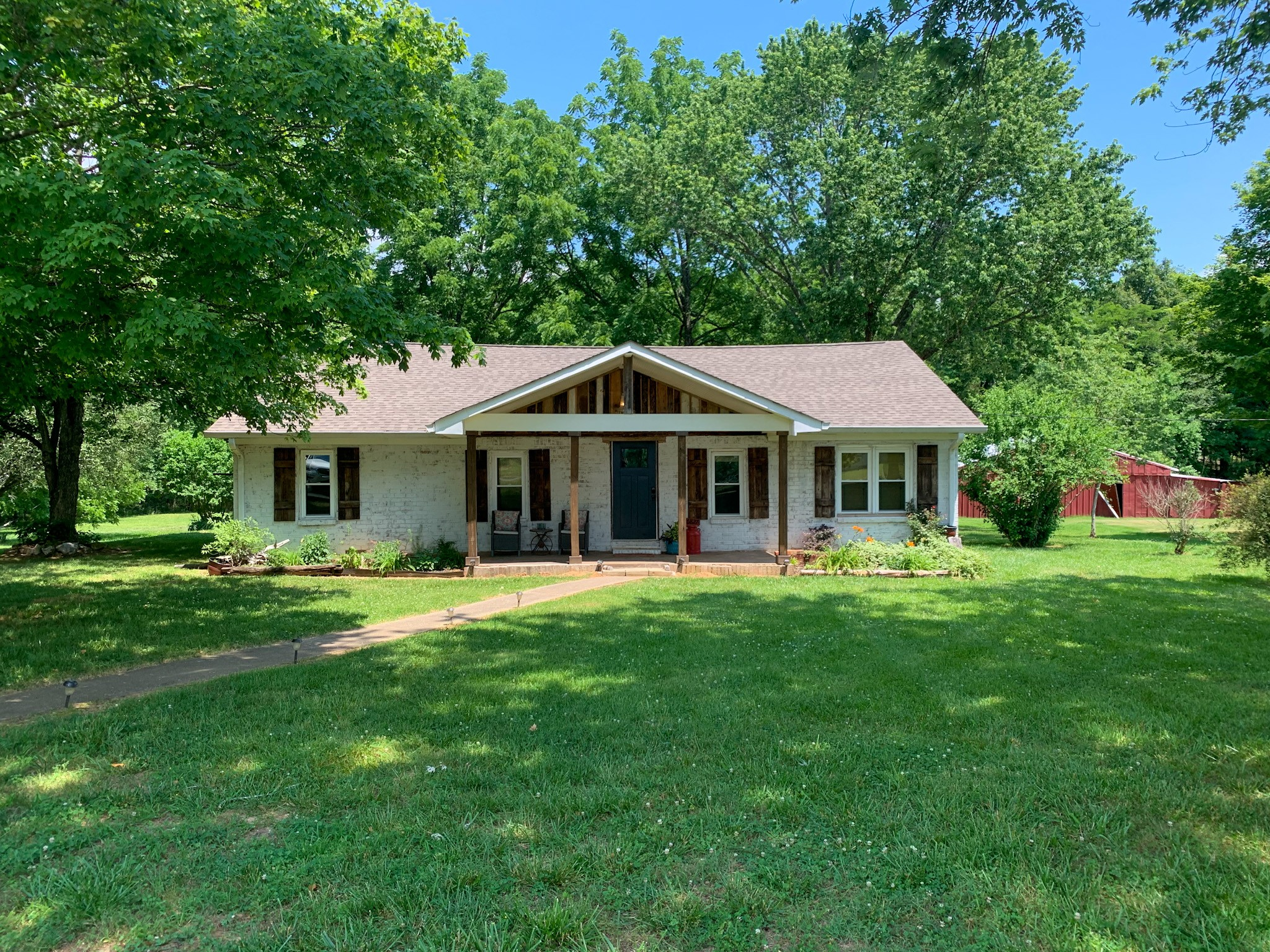 Beautifully updated ranch home on 3acres. This 3br 2 bath home has been fully renovated and offers gorgeous hardwood floors, open floor plan, & stylish kitchen & baths. Enjoy your morning coffee on your back deck, or have a party - there is room for everyone. Also includes barn/outdoor buildings for your favorite animals and equipment.