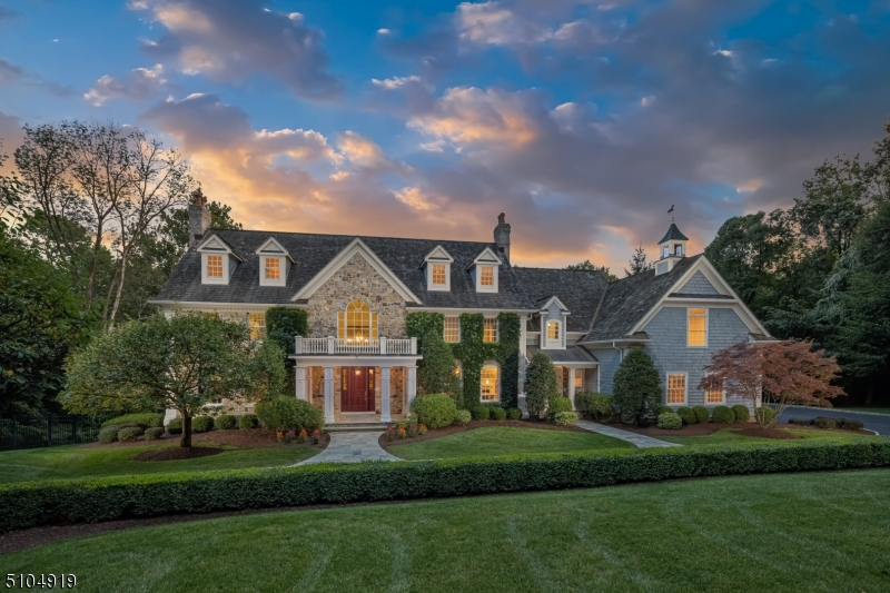 This beautiful and graciously styled custom home is centered on over five resort-caliber acres. Located in a sought after Bernardsville Mountain location, the professionally landscaped grounds provide outstanding amenities that include a beautiful pool with stone waterfall, stone walls, a series of covered and open terraces and decking ideal for outdoor entertaining. Expansive green lawns and mature trees also highlight the setting. Four finished levels of bright and thoughtfully sized rooms encompass the interiors of this 11,000' +/-  home. The modern and open floor plan features a formal living room and dining room, beautifully renovated kitchen that opens to the great room with soaring stone fireplace, a first floor bedroom suite,  a private mahogany paneled library and additional home office spaces on each level. Recently refinished hardwood floors and high ceilings are found throughout. The 4,000' finished LL includes a Billiard room w/ wet bar, Exercise Room, Rec Room with kitchenette, full bath with changing room to accommodate the pool and a Game Room all of which have outdoor access. Photos that include furniture / accessories are virtually staged.