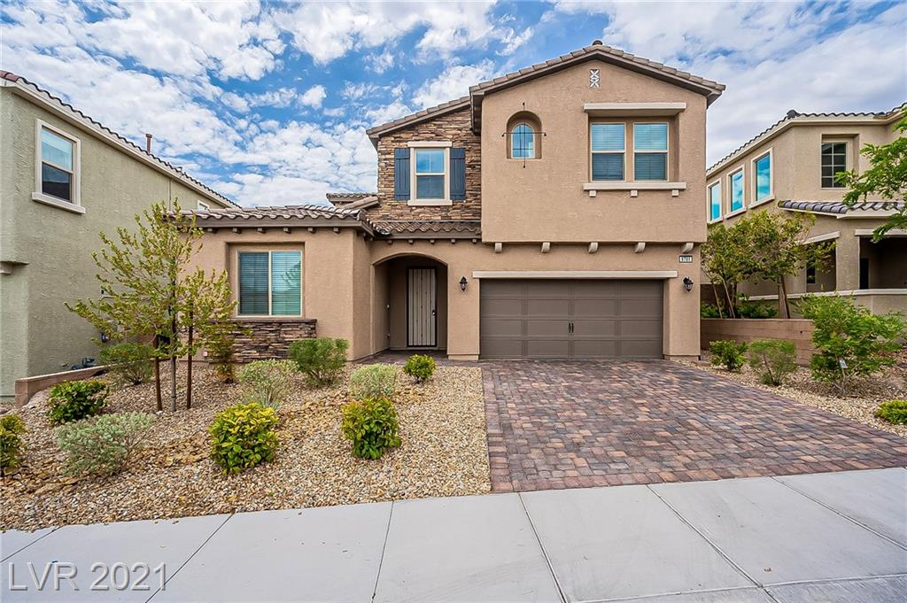 Built in 2018, this Las Vegas two-story home offers a patio, quartz countertops, and a two-car garage.