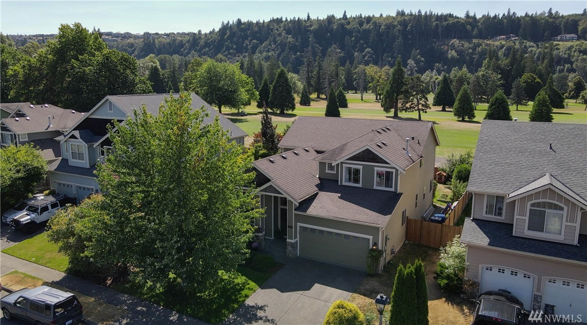 Captivating craftsman on the 5th fairway of High Cedars. Imagine sunsets over the Puyallup ridgeline as you watch the last group of golfers pass from the back patio. Just a short walk on the paved trail from the back gate leads you to the Puy. River where you can fish, wet your toes, or just relax & listen to the tranquil sounds. Your home awaits with its soaring 18' ceilings & endless natural wood features. Spacious Main Flr Owners Suite and office/den/flex possible 4th bedroom!