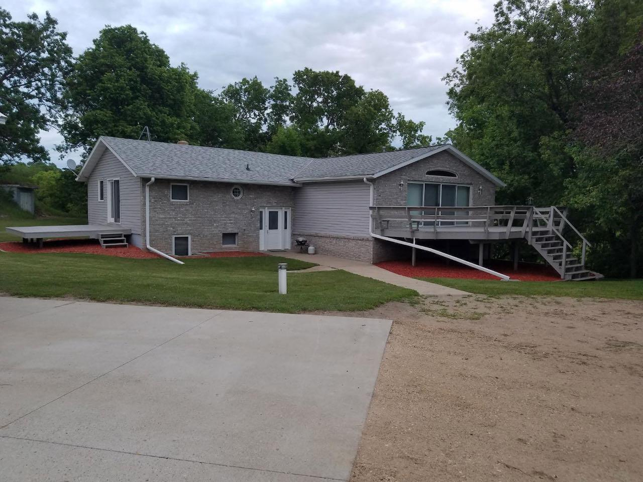 Fantastic home on 6.17 acres. Outbuildings include a 34x40 triple stall oversized garage that is core filled and frost footings, 10' sidewalls. A quonset is 24x32.  A 48x32 building that is partially heated and wall air conditioner. With above storage mezzanine. The workshop measures 24X32, garage area is 24x32. Underground storage building that is 12x30, great area to build a smoker, create and store your own beer/wine. Home features 3 bedrooms, a massive living/great room, overlooking a gorgeous wildlife area. The second living/family room overlooks the front of the home and has a gas fireplace. Both of these are on the main floor of the home. The third living/Family room is in the basement, great place to send the kids for their get togethers, video games and/or movie nights. Home also has the great feature that the main floor has the master bedroom and two bedrooms in the lower level. Huge storage area that easily could convert to bathroom.