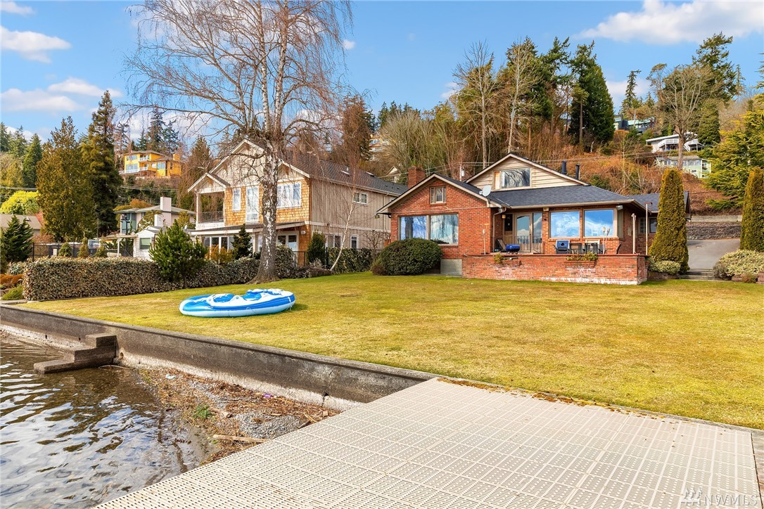 Superb Lake Wash property with easy access off Juanita Dr. Update current house, build your dream home or develop multiple dwellings. Dock included in the sale. 72' of waterfront. 4bd/2.5ba with great lake views. Large family room and sauna in basement. Unlike many properties in area there is minimal slope. W/ current location of bldgs, setbacks may be grandfathered in for greater options. All data to be confirmed by buyer and is not a claim or guarantee from the seller/broker.